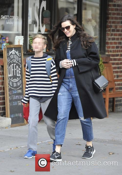 Pregnant Liv Tyler walking her son, Milo to...