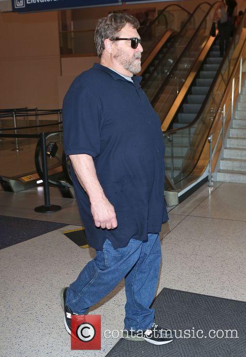 John Goodman arrives at Los Angeles International (LAX)...