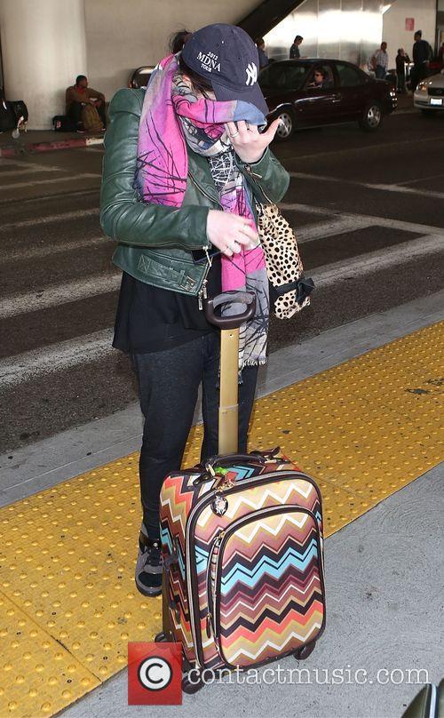 Michelle Trachtenberg arrives at Los Angeles International (LAX)...