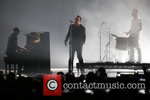 The Edge (l-r), Bono and Larry Mullen Jr. Of U2 1