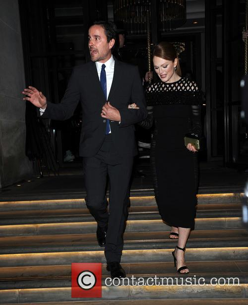 Julianne Moore and partner leave a hotel in...