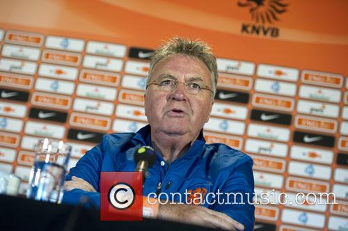 Guus Hiddink at a press conference