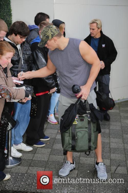 WWE Superstars sign autographs