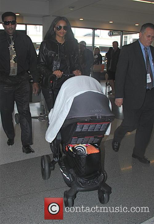 Ciara with her family departing Los Angeles International...
