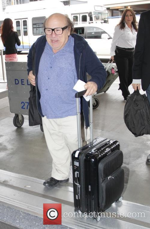Danny DeVito is all smiles as he arrives...