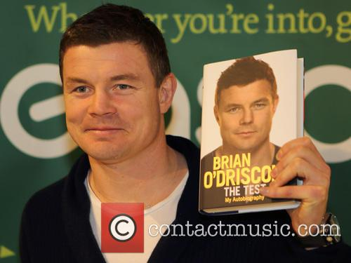 Retired Irish rugby player Brian O'Driscoll signs copies...