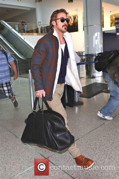 Ryan Gosling arrives at Los Angeles International Airport...