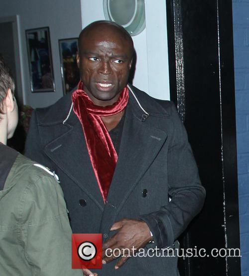Chris Martin and Seal are seen leaving a...