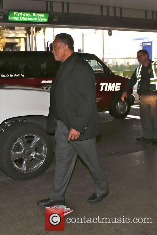 Jesse Jackson looks for his car at Los...