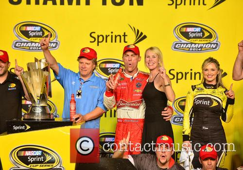 Team Owner Tony Stewart, Kevin Harvick, Driver Of The #4 Budweiser Chevrolet and Delana Harvick 3
