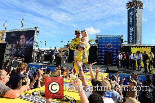 Matt Kenseth, Driver Of The #20 Dollar General Toyota and Holds His Daughter Grace 2