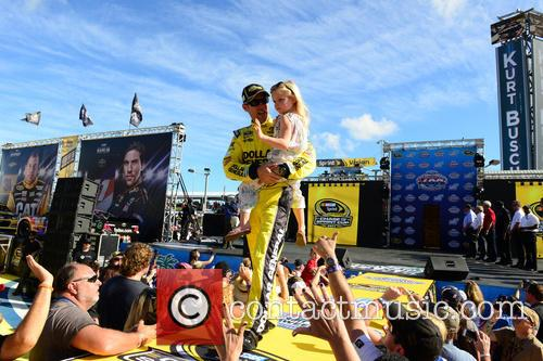 Matt Kenseth, Driver Of The #20 Dollar General Toyota and Holds His Daughter Grace 1