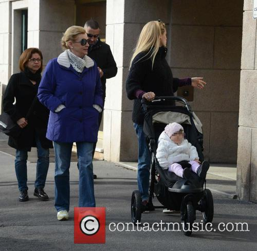 A pregnant Michelle Hunziker goes for a walk...