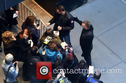 Hugh Jackman Signs Autographs for Fans at Broadway...