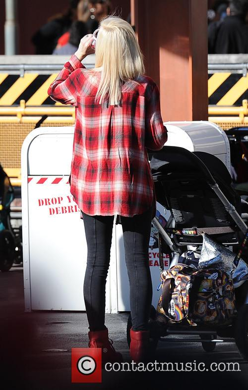 Gwen Stefani spends the day at Disneyland with...