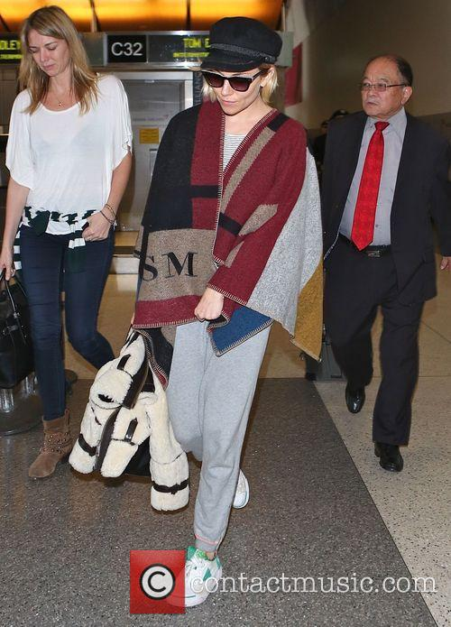 Sienna Miller arrives at Los Angeles International (LAX)...
