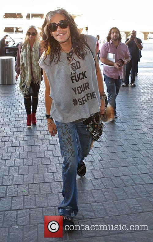 Steven Tyler arrives at Los Angeles International (LAX)...
