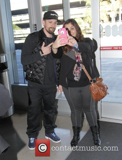 Benji Madden poses with a fan