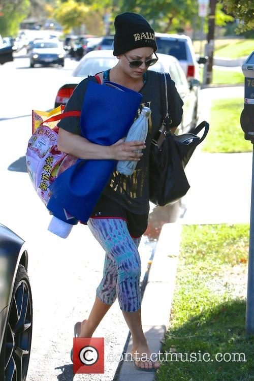 Kaley Cuoco leaves a yoga class wearing a...