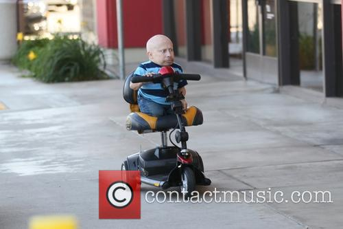 Verne Troyer gets money out of an ATM