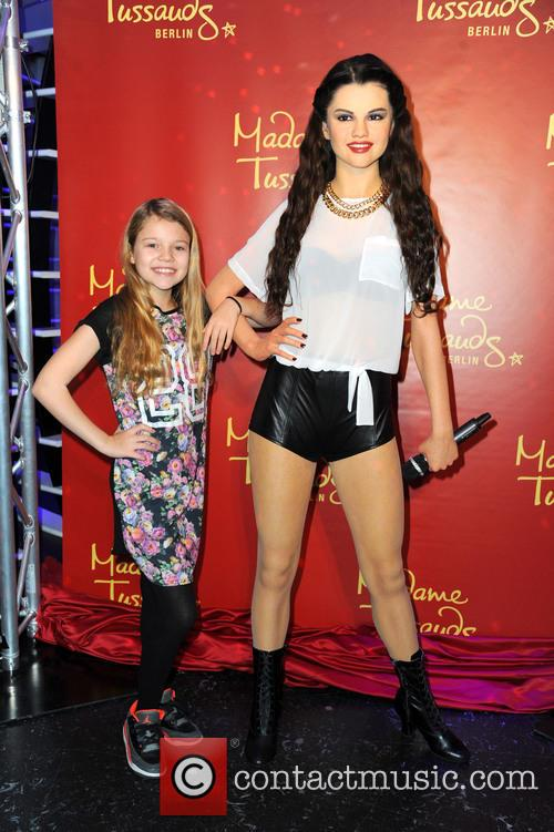 Faye Montana unveiling the wax figure of Selena...