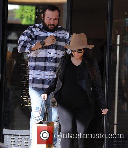 Kourtney Kardashian and Scott Disick shop at Barneys...