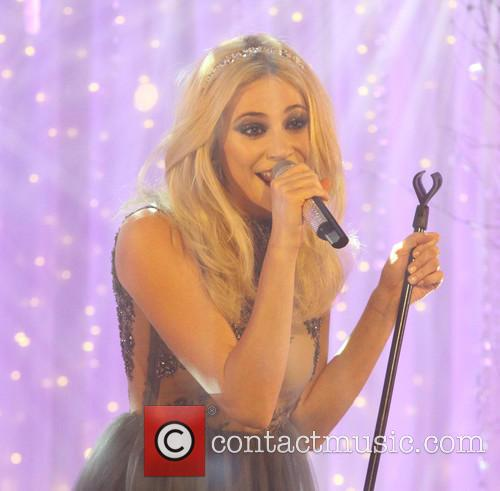 Pixie Lott performs live in front of shoppers
