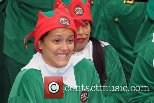 Rosario Dawson and 100 elves spread holiday cheer...
