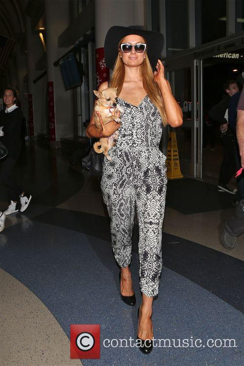 Paris Hilton leaves Los Angeles for Miami with...