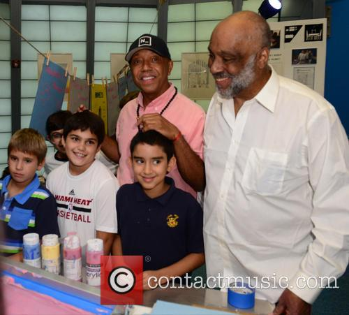 Russell Simmons and Daniel Simmons Jr. 6