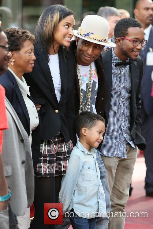 Pharrell Williams, Helen Lasichanh, Rocket Williams and Carolyn Williams 11