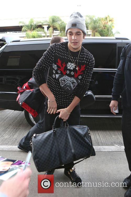 Austin Mahone departs from Los Angeles International Airport...