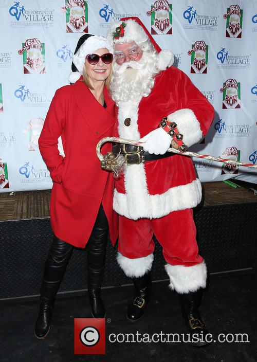 Olivia Newton John and Santa 11