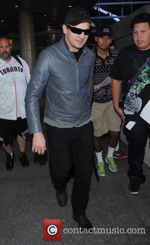 Jeremy Renner arrives at Los Angeles International (LAX)...