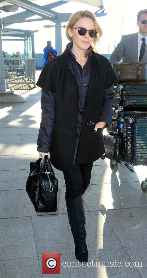 Kylie Minogue leaves London Heathrow airport