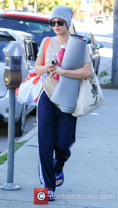 Kaley Cuoco leaves yoga wearing a hat and...