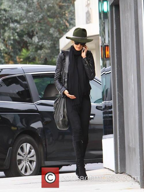 Kimberly Stewart out and about talking on her...