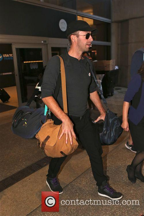 Chris Martin arrives s at LAX airport in...