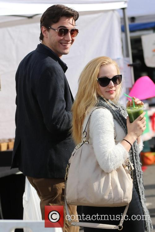 Dove Cameron and Ryan McCartan at the Farmers...