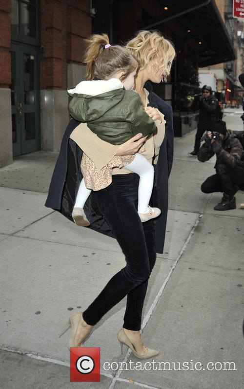 Sienna Miller leaving her hotel with her daughter
