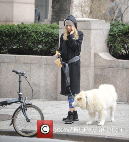 Suki Waterhouse walks her dog