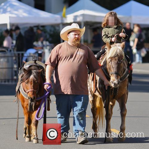 Skyler Berman rides a pony at the Farmers...