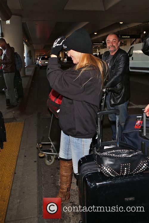 Lita Ford in good spirits at Los Angeles...