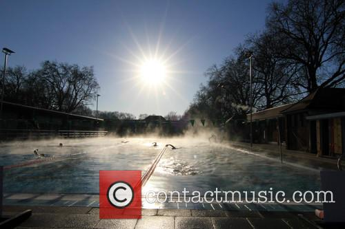 View and Swimmers In Steamy Lido Of London Fields. 7