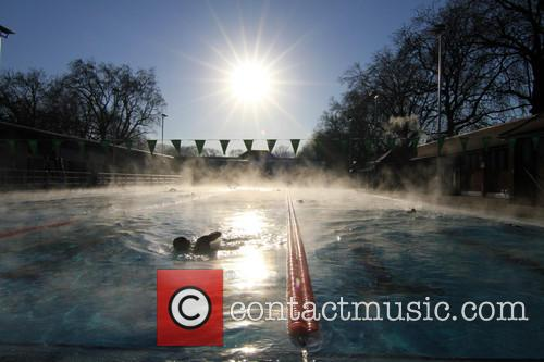 View and Swimmers In Steamy Lido Of London Fields. 9