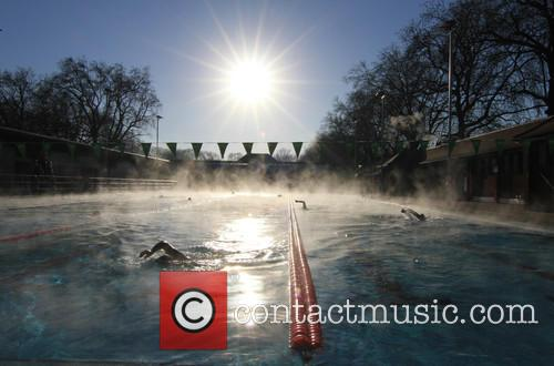 View and Swimmers In Steamy Lido Of London Fields. 10