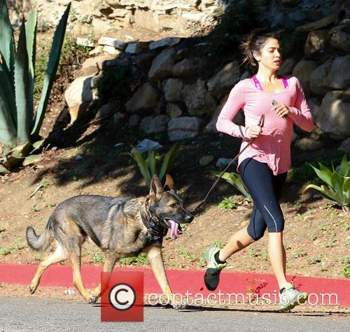 Nikki Reed and her dog go for a...