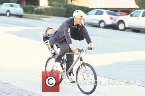 Josh Duhamel spotted out biking with his son...