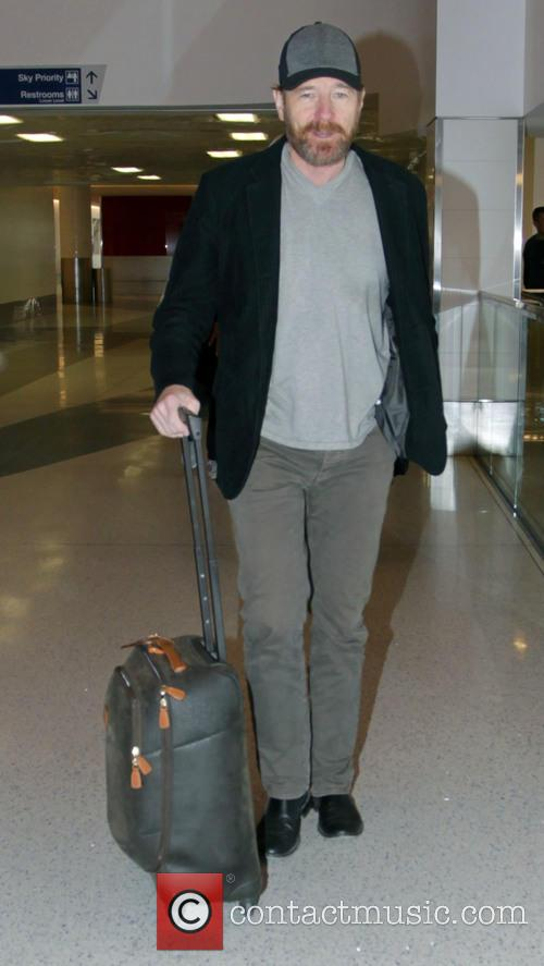 Bryan Cranston departs from Los Angeles International Airport