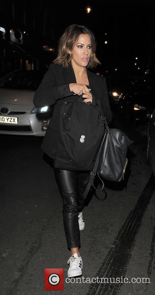 Caroline Flack arrives for dinner in Soho alone....